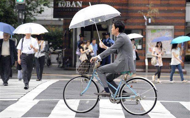 японский велосипедист