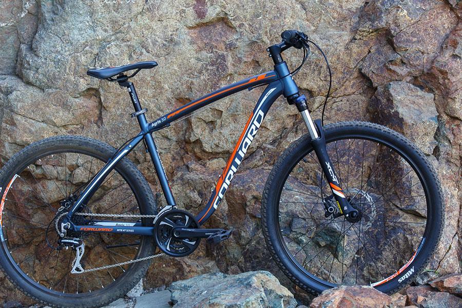 Темно-синий матовый велосипед Forward Agris 3.0