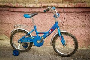 Велосипед с боковыми колесами